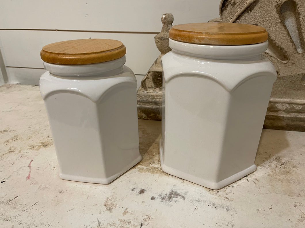 Pair of ceramic canisters with wood lids