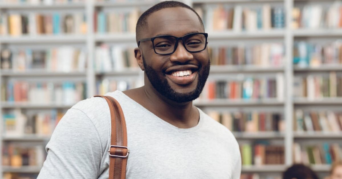Man in library smiling