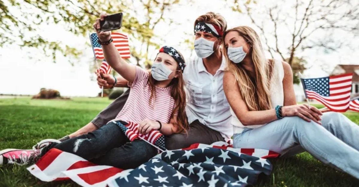American family taking a picture with masks on.