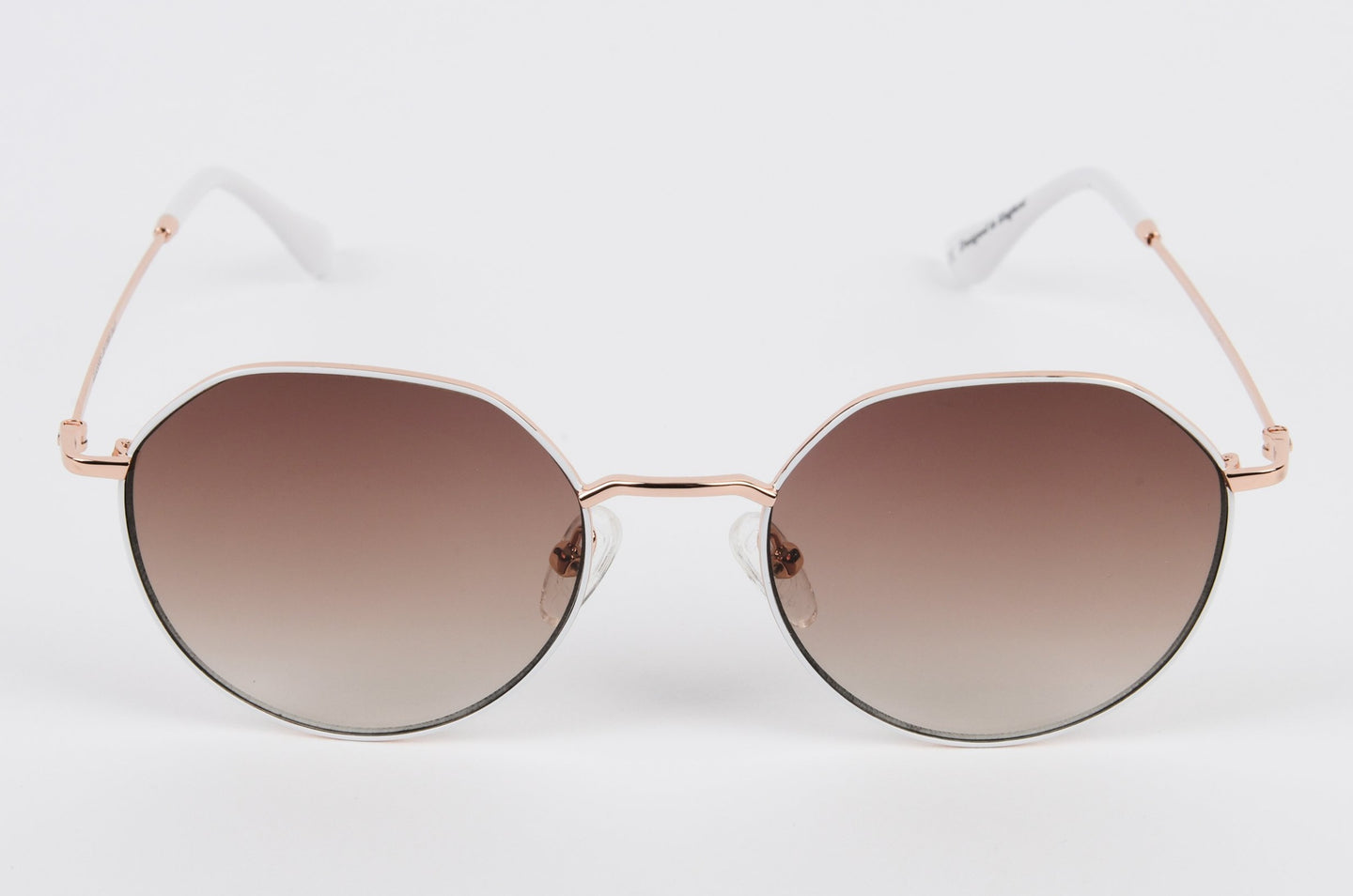 Rose gold titanium sunglasses with brown tint