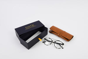 Prescription glasses with box packaging and personalised leather case