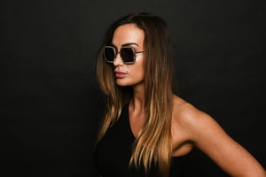 woman wearing sunglasses in black dress