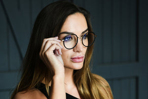 Beautiful woman wearing prescription glasses with anti-reflective coating
