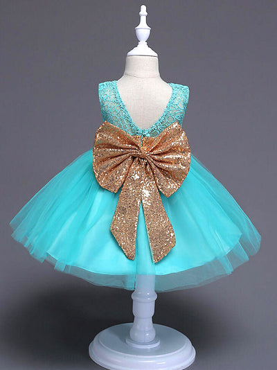 Green princess party dress with oversized gold bow