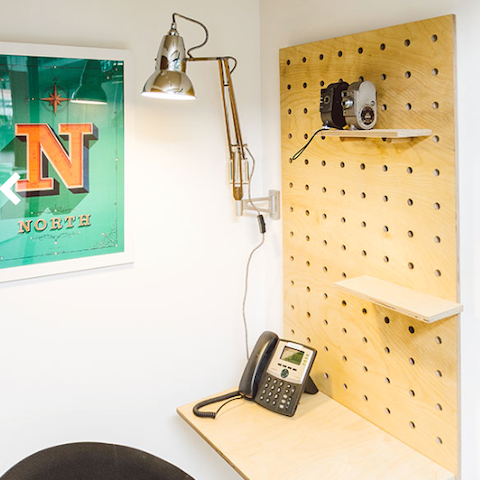 Custom pegboard for a telephone room in an office by Kreisdesign