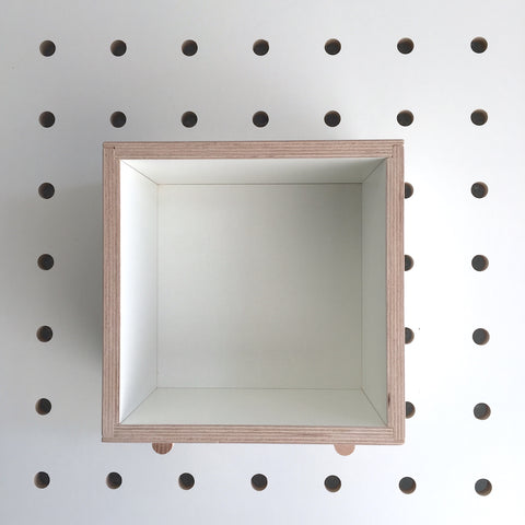 Wooden box in white plywood for pegboard