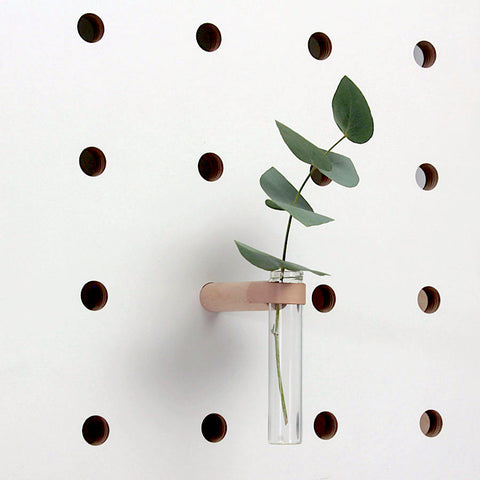 Peg fitted with little vase for plant flowers on pegboards