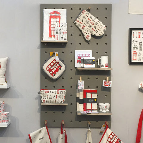 Pegboard painted grey for Victoria Eggs Trade show stand by Kreisdesign. Include pegs and shelves