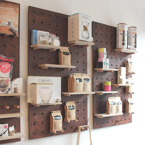 Campbell and Syme coffee shop with bespoke dark stained custom pegboards with birch plywood shelves