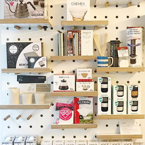 Coffee shop display pegboard with custom pegboard natural birch plywood with shelves by Kreisdesign