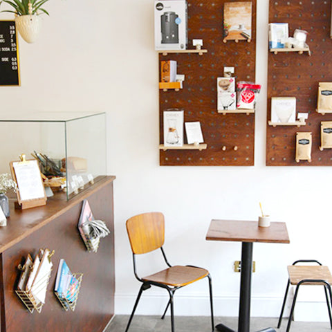 Campbell and Syme coffee shop with bespoke dark stained bespoke pegboards