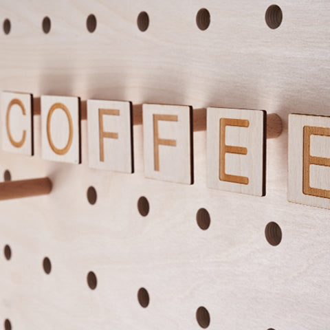 Custom Letters on pegs for coffee shop pegboard by Kreisdesign