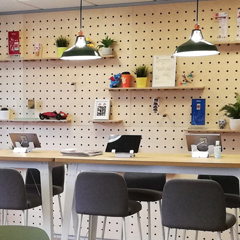 Office wall fit-out with plywood pegboards for a design office in France - made by Kreisdesign