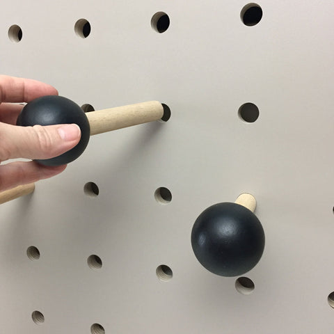 Painted black peg for pegboard by Kreisdesign