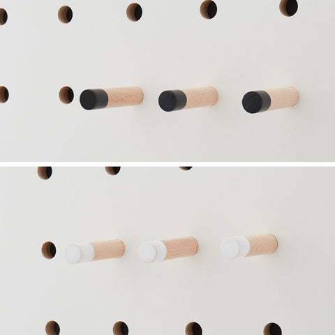Pegs with white and black tips for pegboards by Kreisdesign