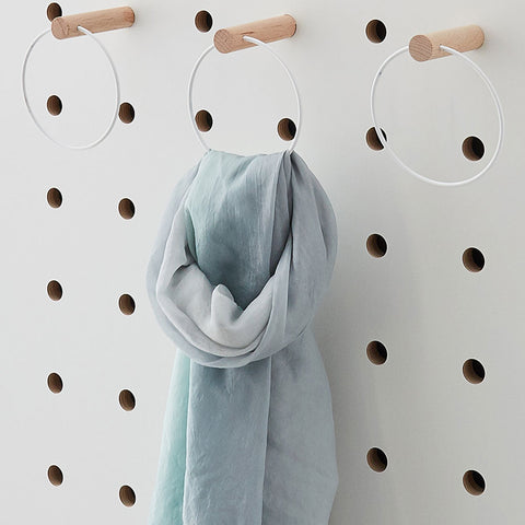 White metal rings on pegs for pegboards by Kreisdesign