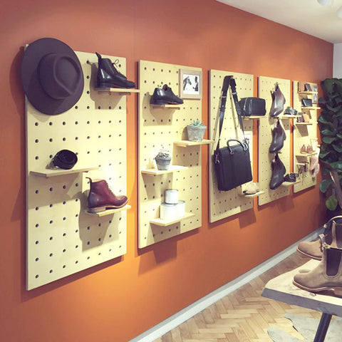 R M Williams store display with Kreisdesign pegboards in natural birch plywood