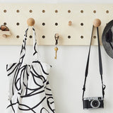 "Peg-it-all ""Skinny"" Pegboard: Wall-mounted Storage Panel in natural wood"