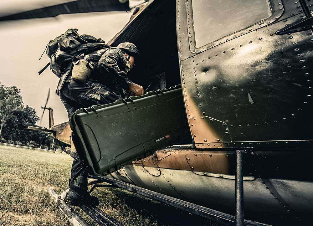 Soldier getting into an Helicopter with a NANUK 990 Hard Case