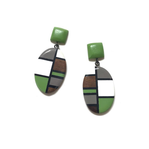 Geometric design in predominately green with brown, white and grey also. An oval drop with a square button at the ear.