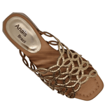 Flat slide of rose gold snake print leather with good foot coverage. Cool for summer fabrics and lighter clothing.
