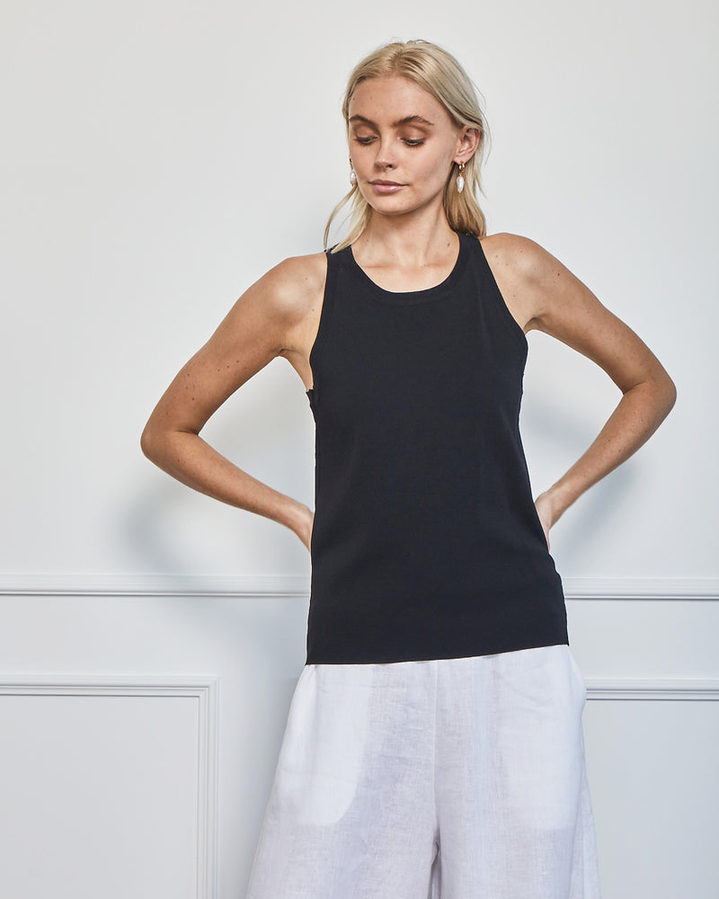 Knitted singlet top will be an asset in your summer wardrobe. Colour black.