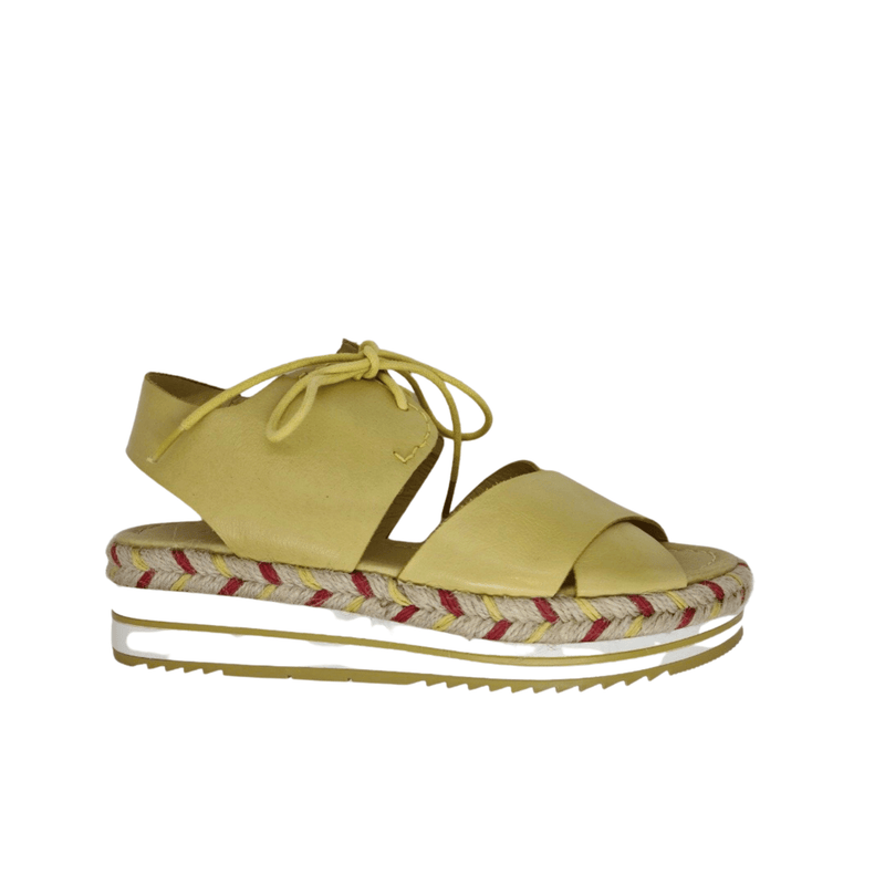 Summer wedge with rubber and multi coloured rope soled flatform. Good foot coverage and ankle support with lace up feature. Colour yellow.
