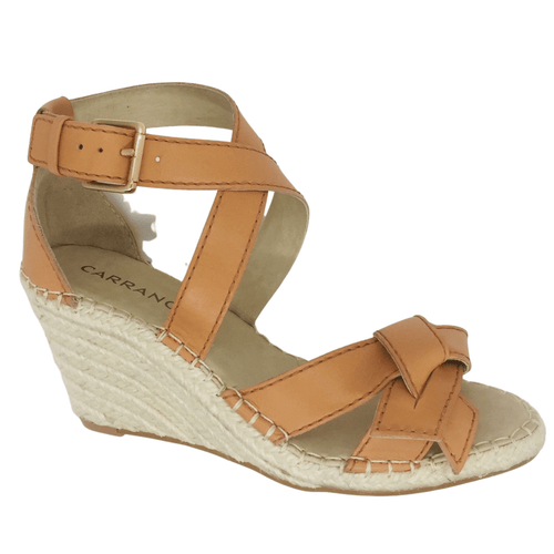 Espadrille wedges with tan strapping around toes and ankle. Buckle around ankle and knotted leather across toes.
