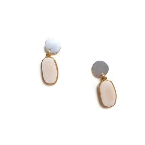 A very pretty drop earring with a matt silver button at the ear and a gold oblong drop with a pale blush stone.