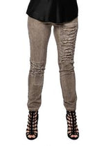 Stretch pants with elastic and drawstring waist, frayed and ripped features, cappuccino
