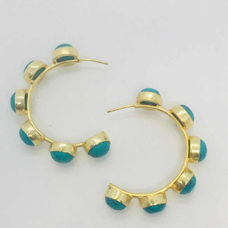 Gold hoop earrings with stones dotted along the hoop. Stone colour turquoise.