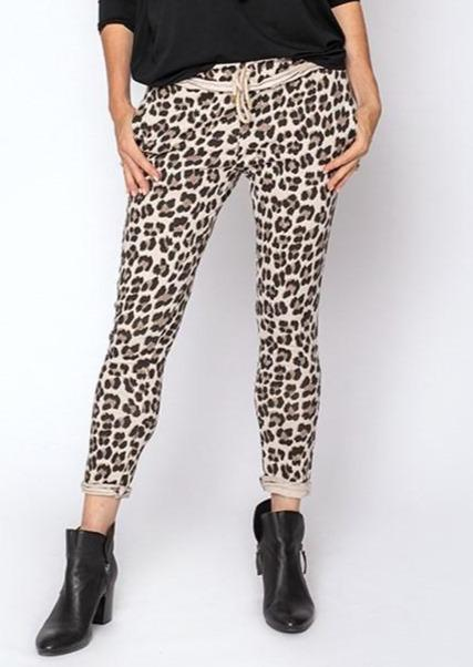Extremely comfortable 100% cotton pants in leopard print. Features inside out trim at waist as well has a rope tie. Pockets are on both front and back.
