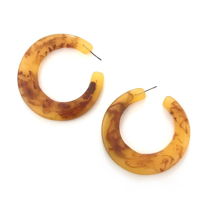 Large hoop earring in an amber colour.