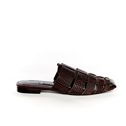 A soft leather snake printed leather flat mule. Colour chocolate.