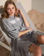 Pinstriped dress with lace inserts, pin tucks and fluted hem. This little summer dress also has a full blouson sleeve, high neckline, bottoned front tie belt. Colour: Licorice stripe.