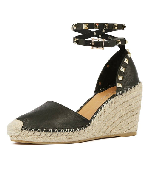 Leather, wedged espadrille with a closed toe, wrap ankle strap with studs, crochet toe and blanket stitching. Wedge is 8cm with 2cm platform. Colour black.