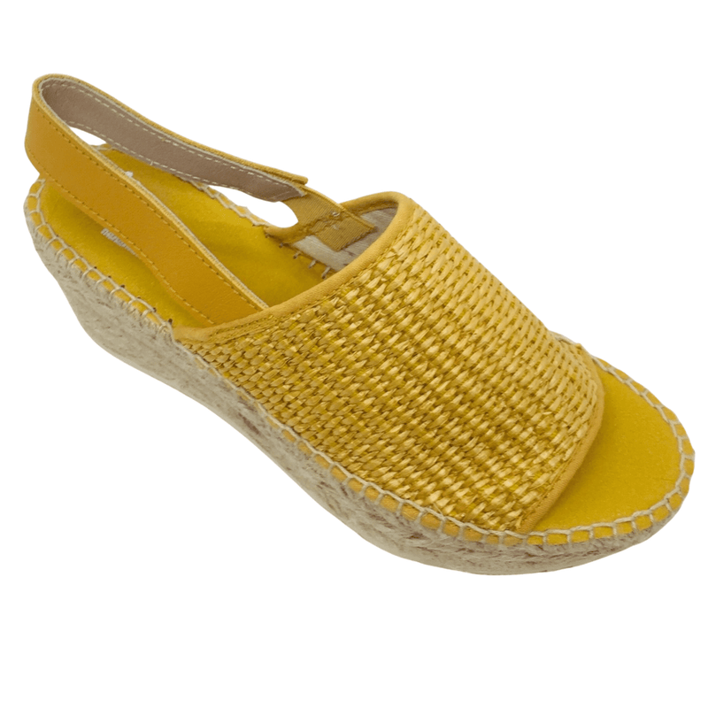 920 × 1920px  Wedged Spanish espadrille with woven elasticated rafie upper and rope wedge. Sling back offers support. Colour mustard.