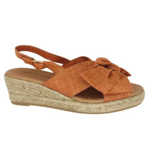 Summer wedged espadrille in linen fabric with crossover front and slingback for good foot coverage and support. A cute bow features. 5cm heel height with 1.5cm platform. Colour cantaloupe.