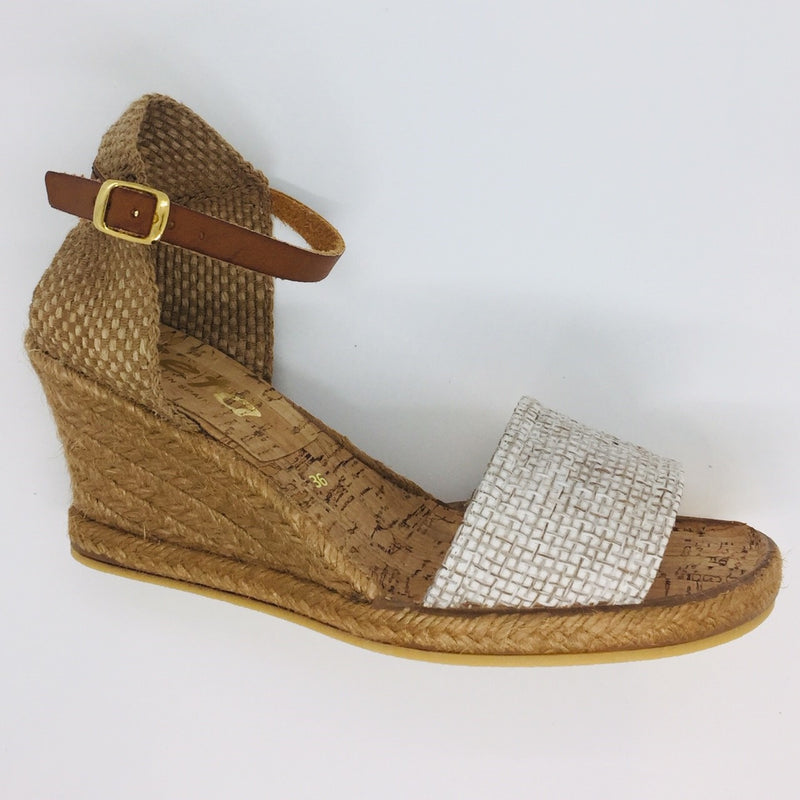 Summer wedge espadrille. Five tier high. 6cm with 1cm platform. Comfortable. Dressed up or down. Worn with pants, shorts, skirts or dresses. Tan leather ankle strap. Hessian heel cup. Jute front.