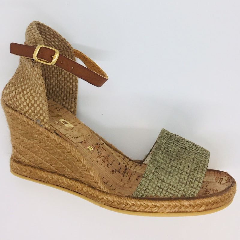 Summer wedge espadrille. Five tier high. 6cm with 1cm platform. Comfortable. Dressed up or down. Worn with pants, shorts, skirts or dresses. Tan leather ankle strap. Hessian heel cup. Jute front. Khaki.