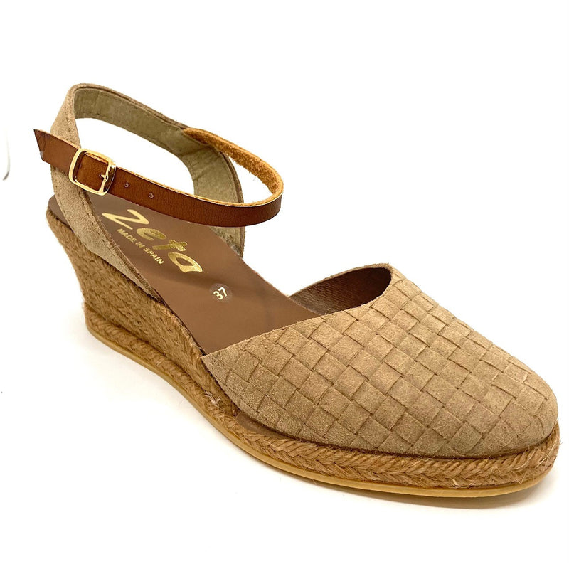 Comfortable wedged five tiered (6cm with 1cm platform) espadrille in suede leather punched to produce a woven effect. It has a y back a closed toe. Colour Arena (camel).