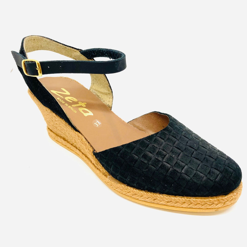 Comfortable wedged five tiered (6cm with 1cm platform) espadrille in suede leather punched to produce a woven effect. It has a y back a closed toe. Colour black.