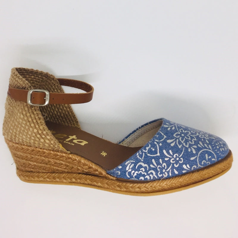 Closed toe wedged espadrille. Denim with a silver trim. Tan leather ankle strap. Comfortable four tier (5cm with 1cm platform) height.