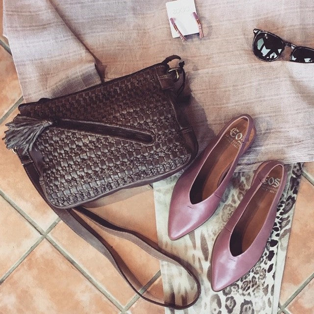 Cross body bag. Two outside zipped pockets both from and back. Inside zip and pockets. Plaited and woven leather front. Plain back. Long strap. MLadys Shoes. Colour Mud.