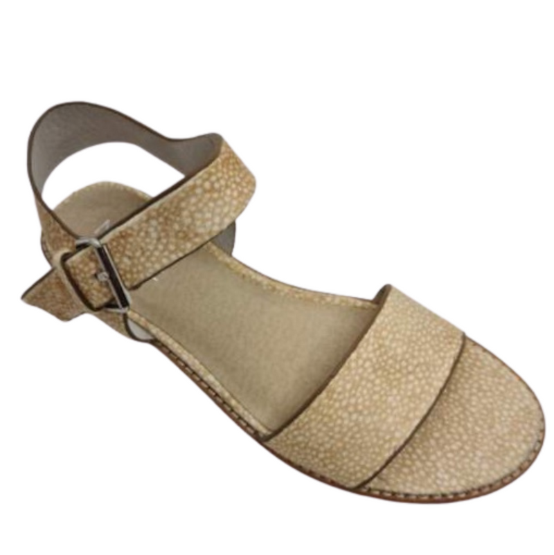 Flat summer sandal in spotted pony hide. Comfortable and available in honey spot pony.
