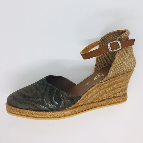 ith snake print and embossed swirls. Tan leather ankle strap. Hessian heel cup.  Khaki leatheEspadrille wedge. Five tiers high. Leather wr.
