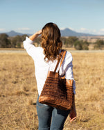 A chic boho shopper bag that's large enough to stash all those daily essentials with handy pockets for the smaller things in life and featuring soft high quality woven leather.