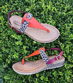 Spongy super soft sole. Man made materials. Thong sandal with slight wedge and back strap. Colours fuschia orange and cheetah.