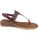 Spongy super soft sole. Man made materials. Thong sandal with slight wedge and back strap. Colours fascia, orange and cheetah.
