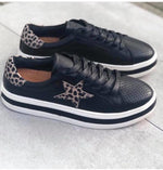 Leather sneaker in black with brown animal print with stars and trim